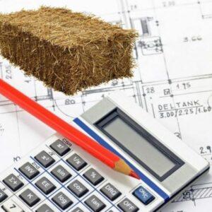 plan, calculatrice, crayon et botte de paille pour illustrer l'économie de la construction paille